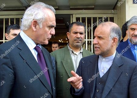 Athens Greece: Greek Minister of Development Akis Tsochatzopoulos (l) Chats with Iranian Oil Minister Bijan Zangeneh (r) During Their Meeting Outside the Ministry in Athens Thursday 31 January 2002 Iran Which Hopes to Boost Its Role As a Natural Gas Exporter is Currently in Talks with the European Union and Greece Zanganeh Said in Athens on Wednesday