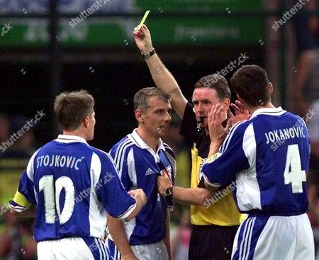 Liege Belgium: Yugoslav Midfielder Vladimir Jugovic (c) Receives a Yellow Card by Scottish Referee Hugh Dallas As Team Mates Dragan Stojkovic (l) and Slavisa Jokanovic Argue During the Euro 2000 Soccer Championship Group C Match Between Norway and Yugoslavia in Liege Sunday 18 June 2000 (electronic Image)