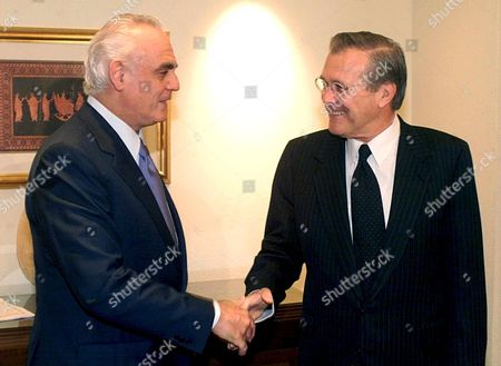 Thessaloniki Greece : Greek Ministar of Defence Akis Tsochatzopoulos (l) Shakes Hands with His Us Counterpart Donald Rumsfeld (r) During Their Meeting in Thessaloniki Wednesday 06 June 2001 in the Frames of the South-eastern European Defence Ministerial Meeting There 5th and 6th June