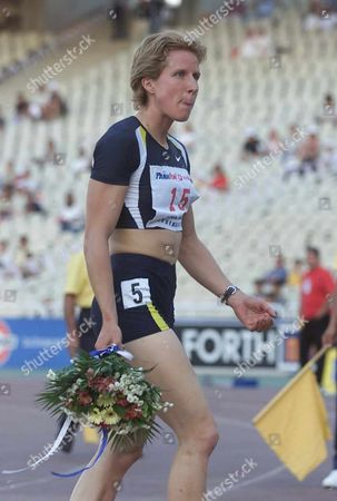 Athens Greece : Britains Katharine Merry Walks with Flowers After Running the Best World Result of 2001 at the Womens 400m with a Time of 49 59sec During the International Outdoor Athletics Meeting Named Tsiglitiria in Athens Monday 11 June 2001