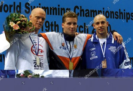 Athens Greece : Mickey Halika of Israel (r) Finlands Jani Sievinen (c) and Rsa^s Terence Parkin (l) Pose on the Podium During the Medal Ceremony For the Winners of Mens 400m Medley Competition at the 5th Fina World Short Course Swimming Championships in Athens on Thursday 16 March 2000