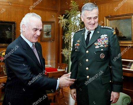 Athens Greece : Greek Minister of Defence Akis Tsochatzopoulos (l) Gestures While Welcoming the Chairman of the Us Joint Chiefs of Staff Gen Henry H Shelton in His Office in Athens Wednesday 2 May 2001
