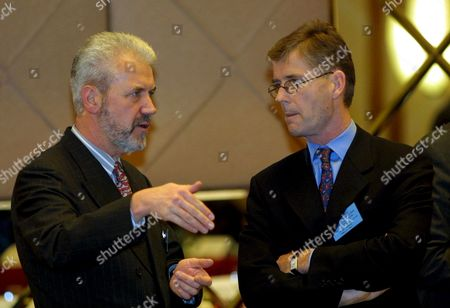 Budapest Hungary : Norwegian Chairman of the Working Table on Security Issues of the Stability Pact For South-eastern Europe Kim Traavik (r) Speaks with German Delegation Leader Bernd Rinnert Prior to the First Day of the Conference in Budapest 27 November 2001
