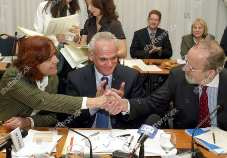 Athens Greece: Greek Minister For Development Akis Tsochatzopoulos (c) Smiles While Eu Commissioner For Energy and Transport Loyola De Palacio (l) Shakes Hands with Stability Pact Co-ordinator Erhard Busek (r) After Signing the Memorandum of Understanding During the Meeting of Balkan Energy Ministers in Athens 15 November 2002
