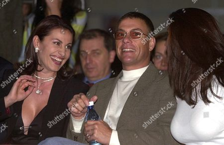 Stock Picture of Sofia Bulgaria : Hollywood Movie Star Jean Claude Van Damme (c) Watches a Fashion Show in Sofia on Late Tuesday 23 October 2001 Flanked by Darina Pavlova (l) Wife of One of Bulgarias Leading Businessmen Ilia Pavlov and an Unidentified Lady the Actor is in Bulgaria For the Shooting of His New Movie