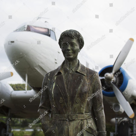Stock Picture of The memorial to Amelia Earhart Putnam at Harbour Grace, Newfoundland, Canada. Earhart was the first woman to fly solo across the Atlantic and took off from the Harbour Grace aerodome in a Lockheed Vega. Teh memorial was sculpted by Luban Boykov.