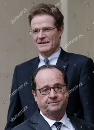 French President Francois Hollande leaves the German ambassador's residence in Paris, France, while German ambassador to France Nikolaus Meyer-Landrut, top, looks, after both attended a short ceremony to pay respect to the 12 killed victims of a truck that ploughed into a crowded Christmas market at Breitscheidplatz in Berlin