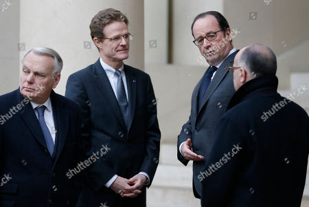 Stock Photo of French President Francois Hollande, 2nd right, Prime Minister Bernard Cazeneuve, right, and Foreign Minister Jean-Marc Ayrault, left, are greeted by Germand ambassador to France, Nikolaus Meyer-Landrut, as they arrive to attend the signing of the condolence book at the German ambassador's residence in Paris, two days after a truck ran into the crowded Christmas market at the Breitscheidplatz in Berlin and killed several people