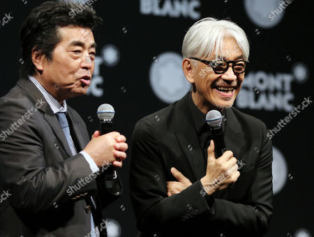 Japanese composer Ryuichi Sakamoto, a member of the Yellow Magic Orchestra (YMO) is celebrated from his friend and a Japanese author Ryu Murakami (L) after he received Montblanc de la Culture Arts Patronage Award