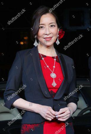 Stock Picture of Japanese actress Miki Maya (Japanese Actress) displays the new Panamera of German sports car maker Porsche