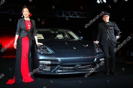 Japanese actress Miki Maya (Japanese Actress) (L) and Yukihiro Takahashi, a member of the Yeloow Magic Orchestra (YMO) display the new Panamera of German sports car maker Porsche