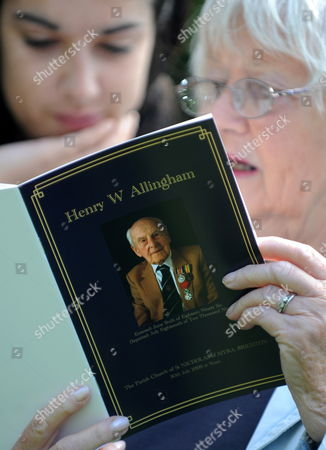 A Woman and Her Granddaughter Look Over the Order of Service During the Funeral Service of the World's Oldest Man Henry Allingham at St Nicholas Church in Brighton Britain 30 July 2009 Henry Allingham the World's Oldest Man and One of the Last Surviving World War i Servicemen Died at the Age of 113 18 July Mr Allingham Served with the Royal Naval Air Service in Wwi Later Transferring to the Royal Air Force at the Time of Its Creation United Kingdom London