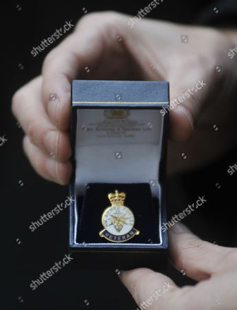 Former British Soldier and Anti-war Campaigner Joe Glenton (hands Pictured) Displays His Veterans Medal Prior to Handing It Back to the Government at 10 Downing Street in London Britain 19 November 2010 Reports State That Glenton who was Jailed For Refusing to Return to Afghanistan Handed His Military Medals Over to Prime Minister David Cameron He was Joined by a Deputation of Military Families who Will Delivered a Letter Calling For the Government to Bring the Troops Home United Kingdom London