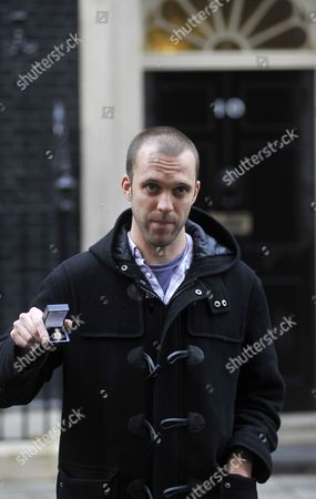 Former British Soldier and Anti-war Campaigner Joe Glenton Hands His Military Veterans Medal Back to the Government at 10 Downing Street in London Britain 19 November 2010 Glenton who was Jailed For Refusing to Return to Afghanistan Handed His Military Medals Over to Prime Minister David Cameron He was Joined by a Deputation of Military Families who Will Delivered a Letter Calling For the Government to Bring the Troops Home United Kingdom London