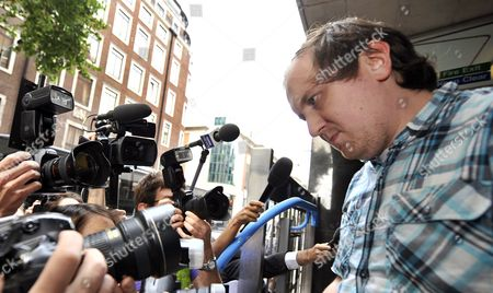 Jonathan May-bowles (r) Exits the Westminster Magistrates Court in London Britain 29 July 2011 May-bowles the Protester Accused of Throwing a Paper Plate of Shaving Foam at Rupert Murdoch As He Gave Evidence to British Members of Parliament Appeared in Court Charged with Causing Harassment and Alarm Or Distress in a Public Place United Kingdom London