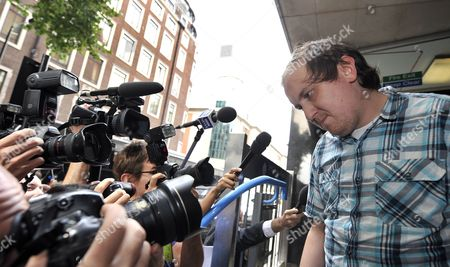 Jonathan May-bowles Exits the Westminster Magistrates Court in London Britain 29 July 2011 May-bowles the Protester Accused of Throwing a Paper Plate of Shaving Foam at Rupert Murdoch As He Gave Evidence to British Members of Parliament Appeared in Court Charged with Causing Harassment and Alarm Or Distress in a Public Place United Kingdom London