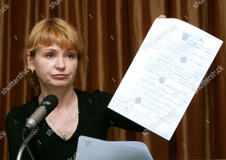 Alla Bout Wife of Alleged Russian Arms Dealer Viktor Bout Shows a Document During a Press Conference in Bangkok Thailand 22 November 2010 Alla is Planning to Sue the Thai Government That Has Approved the Extradition of Alleged Russian Arms Dealer Viktor Bout to the United States and Try to Bring Him Back to Face Charges and Flee Him in Thailand Bout 43 was Arrested in Bangkok in March 2008 in a Sting Operation Led by Us Agents who Posed As Arms Buyers For a Leftist Rebel Group the Revolutionary Armed Forces of Colombia (farc) the Former Soviet Air Force Officer Has Denied Allegations That He Supplied Illegal Arms to Buyers in Africa South America and the Middle East Thailand Bangkok