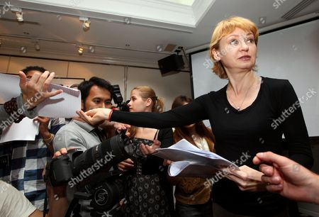 Alla Bout Wife of Alleged Russian Arms Dealer Viktor Bout Hands out Her Statement During a Press Conference in Bangkok Thailand 22 November 2010 Alla is Planning to Sue the Thai Government That Has Approved the Extradition of Alleged Russian Arms Dealer Viktor Bout to the United States and Try to Bring Him Back to Face Charges and Flee Him in Thailand Bout 43 was Arrested in Bangkok in March 2008 in a Sting Operation Led by Us Agents who Posed As Arms Buyers For a Leftist Rebel Group the Revolutionary Armed Forces of Colombia (farc) the Former Soviet Air Force Officer Has Denied Allegations That He Supplied Illegal Arms to Buyers in Africa South America and the Middle East Thailand Bangkok