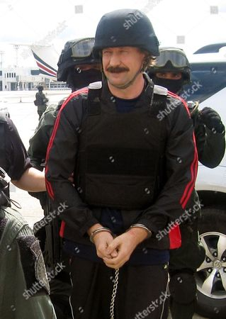 Alleged Russian Arms Dealer Viktor Bout in Handcuffs is Escorted by Thai Special Forces to Board the Airplane For Extradition to the Usa at Don Mueang Airport in Bangkok Thailand 16 November 2010 Bout 43 was Arrested in Bangkok in March 2008 in a Sting Operation Led by Us Agents who Posed As Arms Buyers For a Leftist Rebel Group the Revolutionary Armed Forces of Colombia (farc) the Former Soviet Air Force Officer Has Denied Allegations That He Supplied Illegal Arms to Buyers in Africa South America and the Middle East Thailand Bangkok