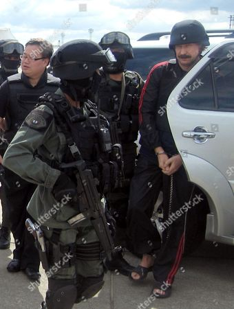 Alleged Russian Arms Dealer Viktor Bout in Handcuffs (r) is Escorted by Thai Special Forces to Board a Chartered Jet For Extradition to the Usa at Don Mueang Airport in Bangkok Thailand 16 November 2010 Bout 43 was Arrested in Bangkok in March 2008 in a Sting Operation Led by Us Agents who Posed As Arms Buyers For a Leftist Rebel Group the Revolutionary Armed Forces of Colombia (farc) the Former Soviet Air Force Officer Has Denied Allegations That He Supplied Illegal Arms to Buyers in Africa South America and the Middle East Thailand Bangkok