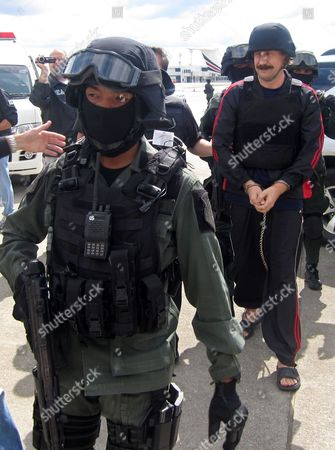 Alleged Russian Arms Dealer Viktor Bout in Handcuffs (r) is Escorted by Thai and Us Special Forces to Board the Airplane For Extradition to the Usa at Don Mueang Airport in Bangkok Thailand 16 November 2010 Bout 43 was Arrested in Bangkok in March 2008 in a Sting Operation Led by Us Agents who Posed As Arms Buyers For a Leftist Rebel Group the Revolutionary Armed Forces of Colombia (farc) the Former Soviet Air Force Officer Has Denied Allegations That He Supplied Illegal Arms to Buyers in Africa South America and the Middle East Thailand Bangkok