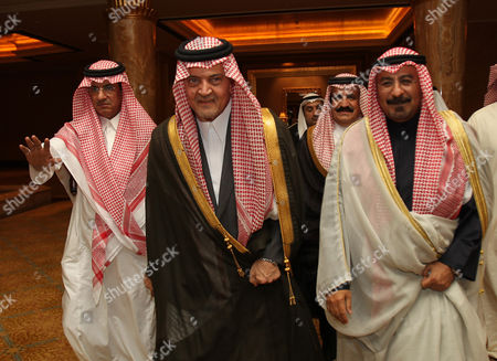 Saudi Foreign Minister Prince Saud Al-faisal (c) and His Kuwaiti Counterpart Sheikh Mohammad Sabah Al-salem Al-sabah (r) Arrive to Attend the Meeting of 118th Gulf Cooperation Council (gcc) Ministrial Council at the Emirates Palace Hotel in Abu Dhabi United Arab Emirates on 07 March 2011 United Arab Emirates Abu Dhabi