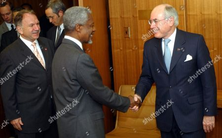 United Nations Secretary-general Kofi Annan (c) Greets Australian Prime Minister John Howard (r) Before the Two Men Held a Meeting at the United Nations This Morning Monday 5 May 2003 at Far Left is Austrialian Ambassador to the Un John Dauth Epa Photo/justin Lane United States New York