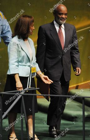 Rene Garcia Preval (r) President of the Republic of Haiti is Escorted to the Podium to Speak During the General Debate of the 65th Session of the United Nations General Assembly at United Nations Headquarters in New York New York Usa 24 September 2010 the General Debate of the Un General Assembly is the Annual Meeting of the Un's One Principal Organ in Which All Member Nations Have Equal Representation United States New York