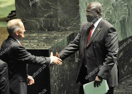 Riek Machar (r) the Vice-president of South Sudan Shakes Hand with Joseph Deiss (r) of Switzerland President of the Sixty-fifth Session of the United Nations General Assembly After Speaking During a Meeting of the United Nations General Assembly where the Newly Formed Nation of South Sudan was Admitted As a New Member of the United Nations at United Nations Headquarters in New York New York Usa on 14 July 2011 United States New York