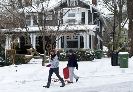 Stock Photo of Emma Mason Left and Katie Argo Right on Route to Pidemont Park to Enjoy the Freshly Fallen Snow in Atlanta Georgia Usa 10 January 2011 After a Snowstorm Dumped About Five Inches of Snow Leaving the Southern City Paralyzed United States Atlanta
