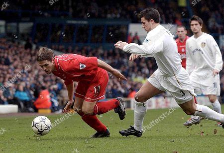 Leeds United Kingdom : Liverpools Michael Owen (l) Evades Leeds Ian Harte During Their English Premiership Clash at Elland Road in Leeds 03 February 2002