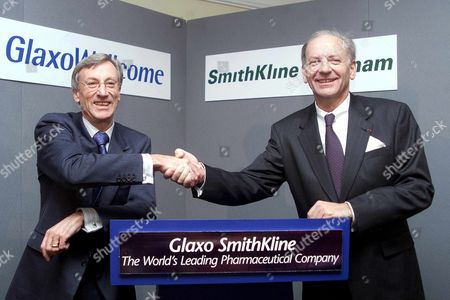 London United Kingdom : Sir Richard Sykes (left) Chairman of Glaxo Wellcome Shakes Hands with Jean-pierre Garnier Chief Executive Officer Elect of Smithkline Beecham at a Photo Call 17 January 2000 at the Brewery City of London For the Proposed 15 Billion Pound (24 9 Billion Usd) Merger of the Two Research-based Pharmaceutical Companies