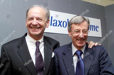 London United Kingdom : Sir Richard Sykes (right) Chairman of Glaxo Wellcome and Jean-pierre Garnier Chief Executive Officer Elect of Smithkline Beecham in Bouyant Mood at a Photo Call 17 January 2000 at the Brewery City of London For the Proposed 15 Billion Pound (24 9 Billion Usd) Merger of the Two Research-based Pharmaceutical Companies