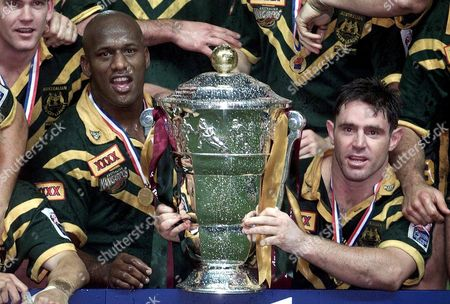 Stock Picture of Manchester United Kingdom : Australias Captain Brad Fittler (r) and Man of the Match Wendell Sailor Celebrate 25 November 2000 After Beating New Zealand 40-12 to Win the Rugby League World Cup Final at Old Trafford