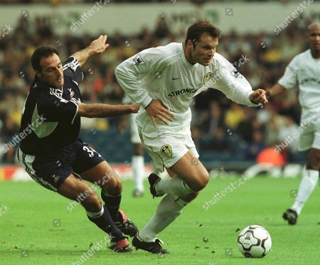 Leeds United Kingdom - Mark Viduka (r) of Leeds United is Challenged by Tottenham Hotspurs Ramon Vega During Their English Premiership Soccer Match in Leeds Late 30 September 2000 Leeds United Went on to Win the Game by 4-3