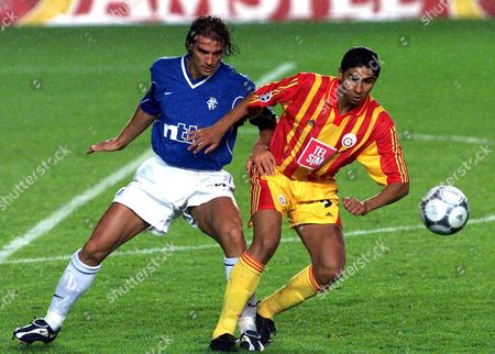 Istanbul Turkey : Galatasaray Istanbul Striker Mario Jardel (r) is Challenged by Glasgow Rangers Defender Lorenzo Amoruso (l) During the Uefa Champions League Match in Istanbul Wednesday 28 September 2000 Galatasaray Won 3-2 (electronic Image)