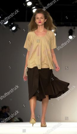London United Kingdom : a Model Presents 16 September 2002 an Oufit of the Joe Casely-hayford Designs During Presentations of Spring/summer 2003 Collections on the Final Day of the London Fashion Week
