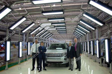 P M Telang Managing Director-india Operations Tata Motors (l) Ralph Seth (2l) Chief Executive Office Jaguar-land Rover Ravi Kant (2r) Vice Chairman Tata Motors and Carl-peter Forster (r) Managing Director and Group Chief Executive Office (ceo) of Tata Motors Poses Next to a Land Rover at the Assembly Line During the Official Inauguration of a Jaguar Land Rover Plant in Pune Some 100kms South of Mumbai India 27 May 2011 the New Facility Will Assemble Land Rover Freelander 2 Vehicles Supplied in Complete Knock Down (ckd) Form From Jaguar Land Rover's Halewood Manufacturing Plant in Liverpool Britain Tata Motors Ltd Indias Biggest Maker of Trucks and Buses Opens a Land Rover Sport-utility Vehicle Assembly Unit at Its Factory in the City of Pune in a Push to Supply Luxury Vehicles to Emerging Economies Tatas Net Income in the Year Through March 31 More Than Tripled to 92 7 Billion Rupees ($2 05 Billion) From 25 7 Billion Rupees As Consolidated Revenue Jumped 33 Percent the Company Said Yesterday Jaguar Land Rover Reported a 1 04 Billion-pound ($1 7 Billion) Profit Compared with a Year-earlier Loss of 14 2 Million Pounds India Pune