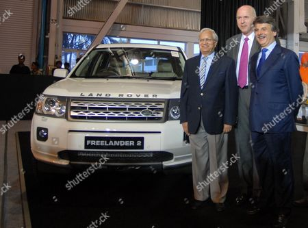 Stock Photo of Ravi Kant (l) Vice Chairman Tata Motors Carl-peter Forster (c) Managing Director and Group Chief Executive Office (ceo) of Tata Motors and Ralph Seth (r) Chief Executive Office Jaguar-land Rover Pose Next to the Land Rover Freelander 2 During the Official Inauguration of a Jaguar-land Rover in Pune Some 100kms South of Mumbai India 27 May 2011 the New Facility Will Assemble Land Rover Freelander 2 Vehicles Supplied in Complete Knock Down (ckd) Form From Jaguar Land Rover's Halewood Manufacturing Plant in Liverpool Britain Tata Motors Ltd Indias Biggest Maker of Trucks and Buses Opens a Land Rover Sport-utility Vehicle Assembly Unit at Its Factory in the City of Pune in a Push to Supply Luxury Vehicles to Emerging Economies Tatas Net Income in the Year Through March 31 More Than Tripled to 92 7 Billion Rupees ($2 05 Billion) From 25 7 Billion Rupees As Consolidated Revenue Jumped 33 Percent the Company Said Yesterday Jaguar Land Rover Reported a 1 04 Billion-pound ($1 7 Billion) Profit Compared with a Year-earlier Loss of 14 2 Million Pounds India Pune