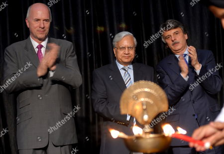 Carl-peter Forster (l) Managing Director and Group Chief Executive Office (ceo) of Tata Motors Ravi Kant (c) Vice Chairman Tata Motors and Ralph Seth (r) Chief Executive Office Jaguar-land Rover Applaud During the Official Inauguration of a Jaguar Land Rover Plant in Pune Some 100kms South of Mumbai India 27 May 2011 the New Facility Will Assemble Land Rover Freelander 2 Vehicles Supplied in Complete Knock Down (ckd) Form From Jaguar Land Rover's Halewood Manufacturing Plant in Liverpool Britain Tata Motors Ltd Indias Biggest Maker of Trucks and Buses Opens a Land Rover Sport-utility Vehicle Assembly Unit at Its Factory in the City of Pune in a Push to Supply Luxury Vehicles to Emerging Economies Tatas Net Income in the Year Through March 31 More Than Tripled to 92 7 Billion Rupees ($2 05 Billion) From 25 7 Billion Rupees As Consolidated Revenue Jumped 33 Percent the Company Said Yesterday Jaguar Land Rover Reported a 1 04 Billion-pound ($1 7 Billion) Profit Compared with a Year-earlier Loss of 14 2 Million Pounds India Pune