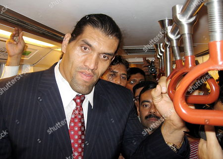 Stock Image of World Wrestling Entertainment (wwe) Wrestler 'The Great Khali' Alias Dalip Singh Rana is Pictured in a Metro Train As He Visits New Delhi India 10 November 2009 Khali Planned to Reach the State of Himachal Pradesh on 11 November where He Would Preside Over the North India Body Building Championships As Special Guest India New Delhi