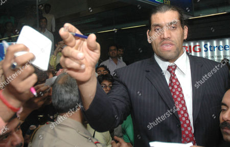 Stock Image of World Wrestling Entertainment (wwe) Wrestler 'The Great Khali' Alias Dalip Singh Rana Signs Autographs As He Visits New Delhi India 10 November 2009 Khali Planned to Reach the State of Himachal Pradesh on 11 November where He Would Preside Over the North India Body Building Championships As Special Guest India New Delhi