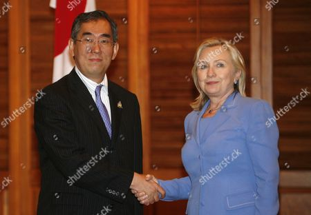 Us Secretary of State Hillary Clinton (r) Shakes Hand with Japan's Foreign Minister Takeaki Matsumoto (l) During Their Bilateral Meeting at the 18th Asean Regional Forum (arf) in Nusadua Bali Indonesia on 23 July 2011 the Indonesian Island of Bali Hosts the 44th Asean Ministerial Meeting (amm) Post Ministerial Conference (pmc) and 18th Asean Regional Forum (arf) From 19 to 23 July Indonesia Nusadua