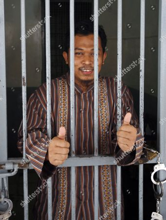 Terrorist Suspect Rohmat Puji Prabowo Alias Bejo (r) Stands Behind Bars Shortly Before His Trial at South Jakarta Court in Jakarta Indonesia 15 June 2010 Rohmat is Charged with Violating Indonesia's Anti-terror Law by Concealing Information and Harboring Terrorists Linked with the July 17 Attacks at the J W Marriott and Ritz Carlton Hotels Indonesia Jakarta