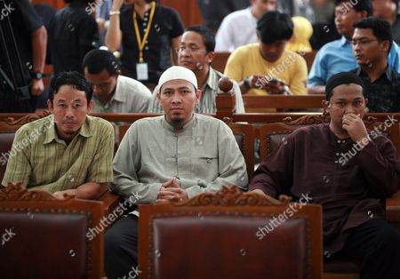 Three Terrorist Suspects Supono Alias Kedu (l) Amir Abdillah (c) and Bejo (r) Wait For the Start of Their Trial at South Jakarta's Court 08 April 2010 the Three Are Charged with Violating Indonesia's Anti-terror Law by Concealing Information and Harboring Terrorists Linked with the July 17 Attacks at the J W Marriott and Ritz Carlton Hotels the Bombings Ended a Four-year Lull in Terrorism in the Muslim-majority Country Indonesia Jakarta