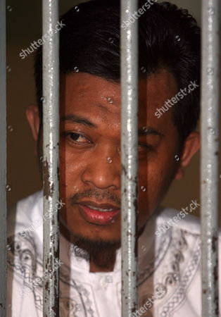 Indonesian Terrorist Suspect Rohmat Puji Prabowo Alias Bejo Stands Behind Bars As He Waits For His Trial in Jakarta Indonesia on 22 June 2010 an Indonesian Court on Tuesday Sentenced Bejo to Seven Years in Prision For Concealing Information and Harboring Terrorists Linked with the July 17 Attacks at the J W Marriott and Ritz Carlton Hotels Indonesia Jakarta
