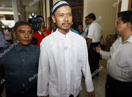 A Father in Law of Terrorist Noordin M Top Baharudin Alias Baridin (c) Escorted by Plainclothes Police to His Trial at the South Jakarta's Court Indonesia 21 Sepetmber 2010 Attorney's Summon Baridin to Six Year in Jail For Violating Indonesia's Anti-terror Law by Concealing Information and Harboring Terrorists Linked with the July 17 Attacks at the J W Marriott and Ritz Carlton Hotels Indonesia Police Said on 21 September 2010 They Were Hunting Terrorists who Escaped a Series of Raids Over the Weekend Targeting a Group Blamed For a Spate of Hold-ups Carried out to Fund Future Attacks the Country's Us-backed Anti-terror Police Shot Dead Three Suspects and Arrested 15 Others in Operations on Sunday on Sumatra Island As Part of Ongoing Investigations Into Bank Robberies and Terror-related Activity Indonesia Jakarta