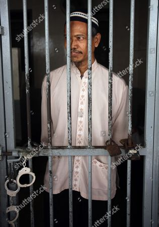 An Indonesian Terror Suspect Also a Father in Law of Alleged Terrorist Noordin M Top Baharudin Alias Baridin Stands Behind Bars Shortly Before His Trial in Jakarta Indonesia 26 October 2010 the Court Sentenced Baharudin to Five Years in Jail For Violating Indonesia's Anti-terror Law by Concealing Information and Harboring Terrorists Linked with the July 17 Attacks at the J W Marriott and Ritz Carlton Hotels Indonesia Jakarta