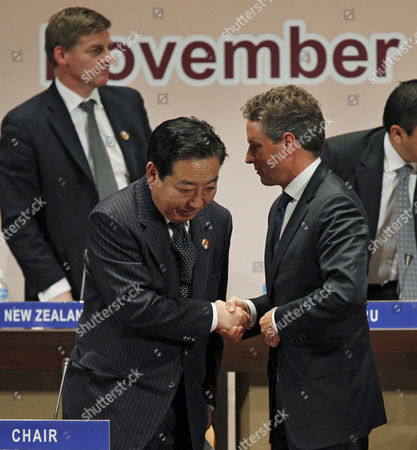 Japan's Minister of Finance Yoshihiko Noda (l) Shakes Hands with Us Secretary of the Treasury Timothy F Geithner at the End of a Joint Press Conference in the Asia-pacific Economic Cooperation (apec) Finance Ministers' Meeting in Kyoto Japan 06 November 2010 Finance Ministers From the Other 20 Countries Responded to Reporters' Questions in the Background is New Zealand's Deputy Prime Minister and Minister of Finance Bill English Japan Kyoto