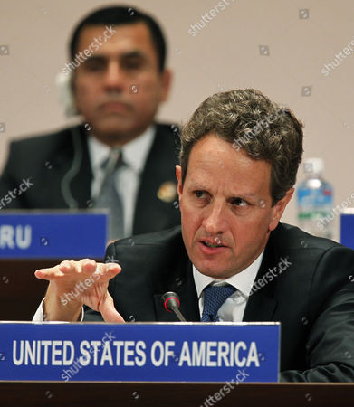Us Secretary of the Treasury Timothy F Geithner Answers a Question During a Joint Press Conference in the Asia-pacific Economic Cooperation (apec) Finance Ministers' Meeting in Kyoto Japan 06 November 2010 Finance Ministers From the Other 20 Countries Responded to Reporters' Questions in the Background is New Zealand's Deputy Prime Minister and Minister of Finance Bill English Japan Kyoto